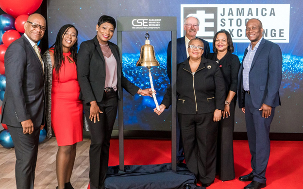 Jamaica Stock Exchange ringing the CSE bell for a market open ceremony.